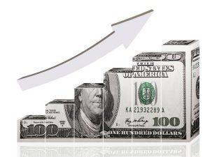 アメリカ紙幣100ドル札が右肩のぼりのグラフ
